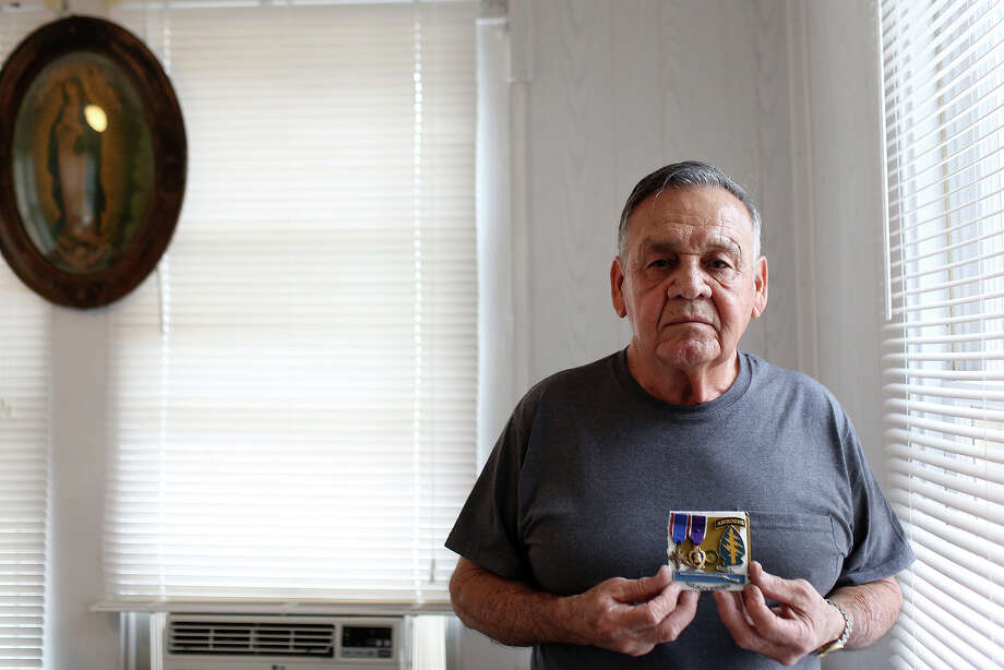 Medal of Honor recipient Jose Rodela holds some of his most prized medals including the Distinguished Service Cross, the Purple Heart (2) and his Special Forces pin at his home in San Antonio on Tuesday, Feb. 18, 2014. Photo: Lisa Krantz, San Antonio Express-News / San Antonio Express-News