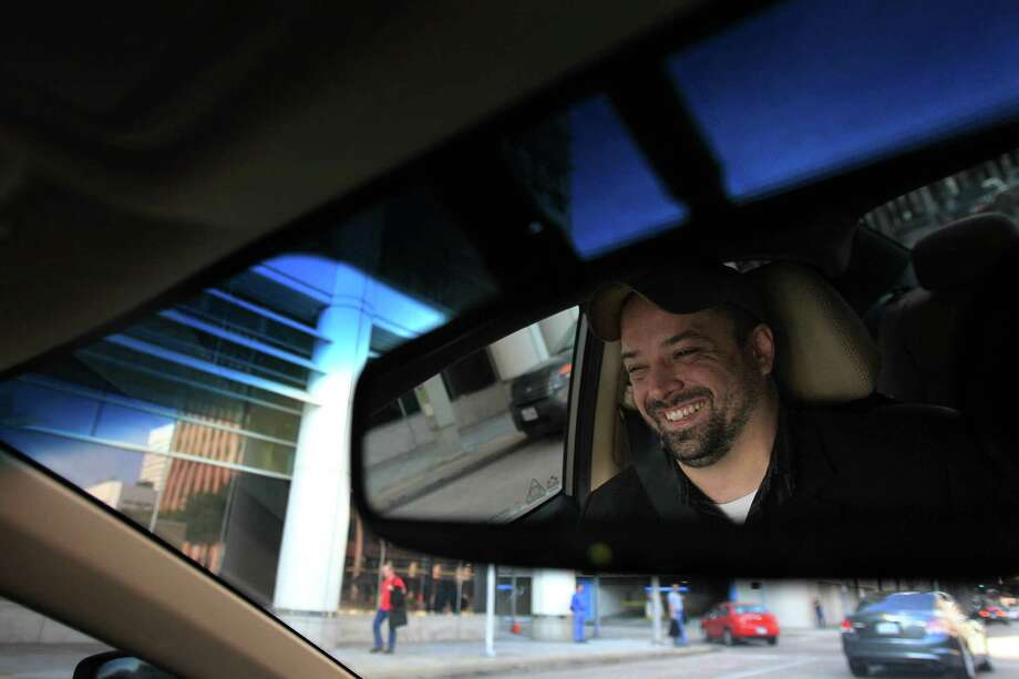 Uber driver Brian Walts participates in the ridesharing services that just launched this week on Friday, Feb. 21, 2014, in Houston. ( Mayra Beltran / Houston Chronicle ) Photo: Mayra Beltran, Staff / © 2014 Houston Chronicle