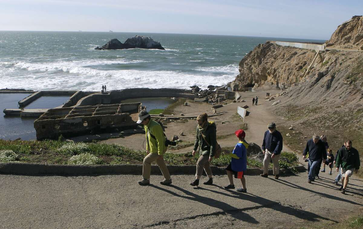 Sightseers hike up the hill after visiting the ruins of the Sutro Baths in San Francisco, Calif. on Wednesday, Feb. 19, 2014. Retired National Park Service employee John Martini just published a book about the historic landmark located north of the Cliff House.