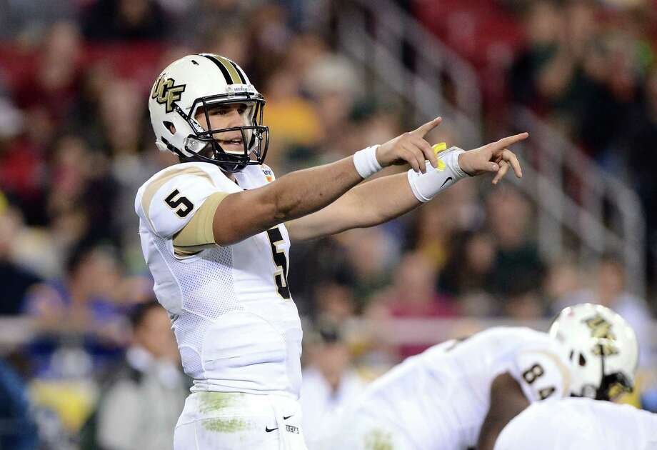 Quarterback Blake Bortles has turned his breakout junior season at Central Florida - including a win over the Penn State team led by Texans coach Bill O'Brien - into a chance to become the Texans' top draft pick. Photo: Jennifer Stewart, Getty Images / 2014 Getty Images