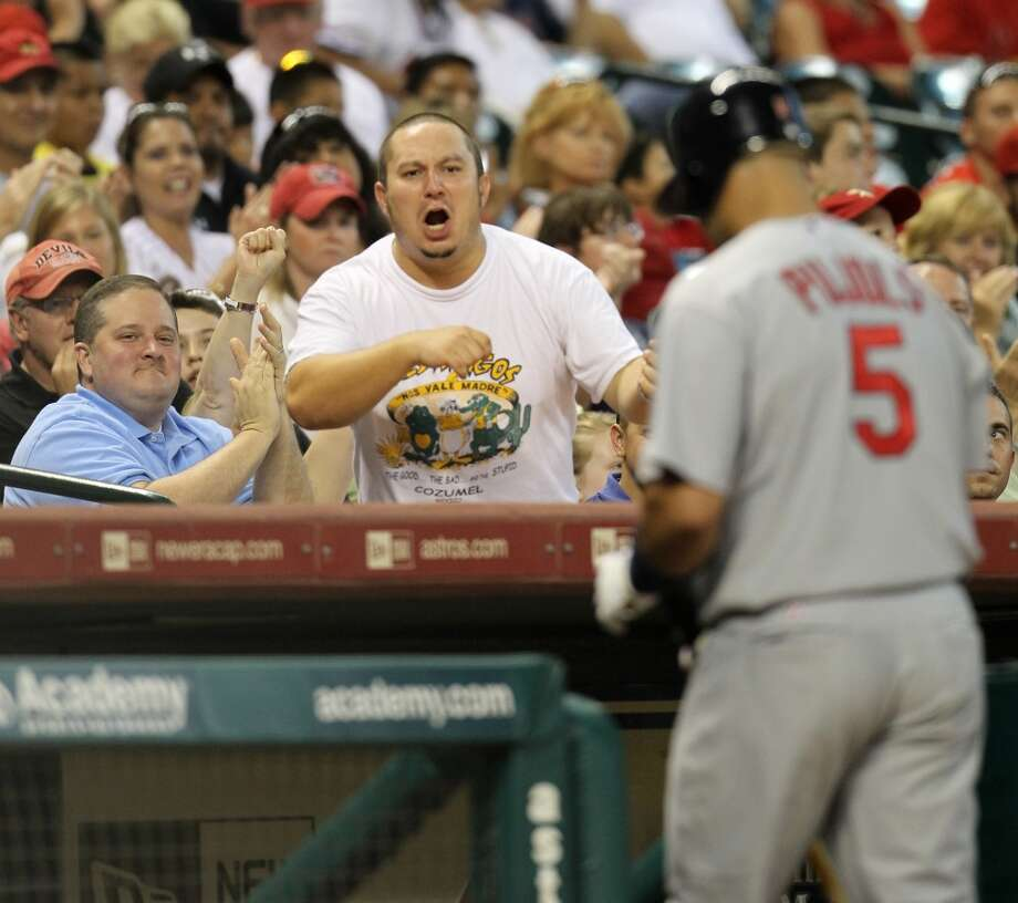 A fan heckles Albert Pujols who walks back to the dugout after striking out during the 9th inning of the Houston Astros-St. Louis Cardinals MLB baseball game at Minute Maid Park,  Saturday, July 10, 2010. Astros won the game 4-1.  ( Karen Warren / Houston Chronicle ) Photo: Chronicle