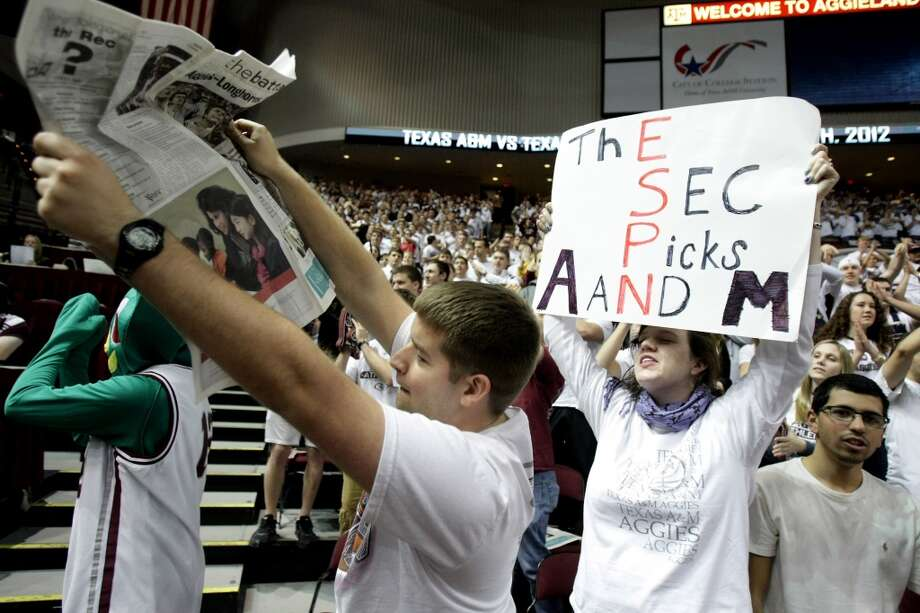 Nicole Resweber, a senior from Baton Rouge, La., tries to get the attention of the ESPN cameras as she heckles the Texas players when they run out onto the floor before a NCAA basketball game, Monday, Feb. 6, 2012, in Reed Arena in College Station( Nick de la Torre / Houston Chronicle ) Photo: Houston Chronicle