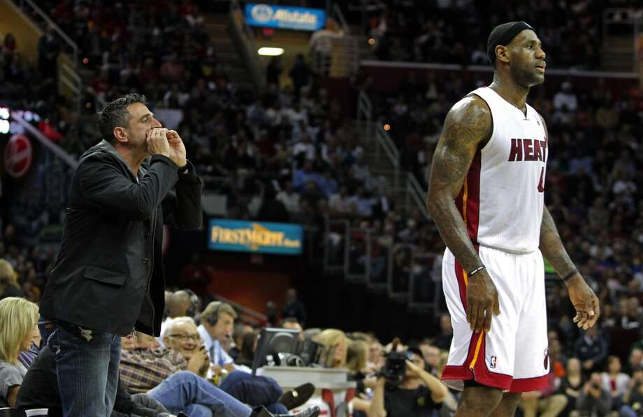 A fan, left, heckles Miami Heat's LeBron James in the first quarter in action against the Cleveland Cavaliers at Quicken Loans Arena in Cleveland, Ohio, on Thursday, December 2, 2010. The game marks the first time James, the former local franchise player, has played in Cleveland since he jumped to the Heat as a free agent. (Phil Masturzo/Akron Beacon Journal/MCT) Photo: MCT