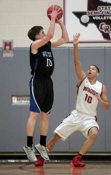 Westside guard Wesley Van Beck takes a shot as Cypress Woods guard Justin Jones (10) defends during the first half of the boys 5A area finals playoff basketball game at Cinco Ranch High School on Friday, Feb. 21, 2014, in Katy. Photo: J. Patric Schneider, For The Chronicle / © 2014 Houston Chronicle