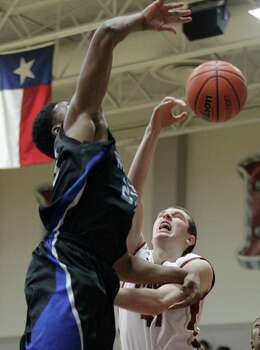 Cypress Woods forward Hogan Choyce, left, defends Westside Franklin Iheanacho during the first half of the boys 5A area finals playoff basketball game at Cinco Ranch High School on Friday, Feb. 21, 2014, in Katy. Photo: J. Patric Schneider, For The Chronicle / © 2014 Houston Chronicle