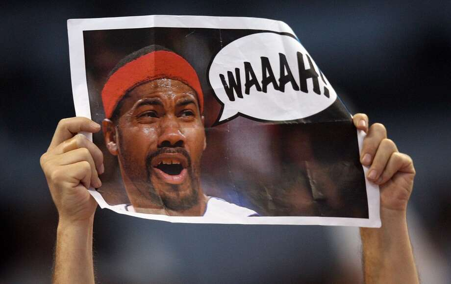 MIAMI - MAY 29:  A Miami Heat fan holds up a sign heckling Rasheed Wallace #36 of the Detroit Pistons in game four of the Eastern Conference Finals during the 2006 NBA Playoffs on May 29, 2006 at American Airlines Arena in Miami, Florida. NOTE TO USER: User expressly acknowledges and agrees that, by downloading and or using this photograph, User is consenting to the terms and conditions of the Getty Images License Agreement.  (Photo by Doug Benc/Getty Images) Photo: Getty Images