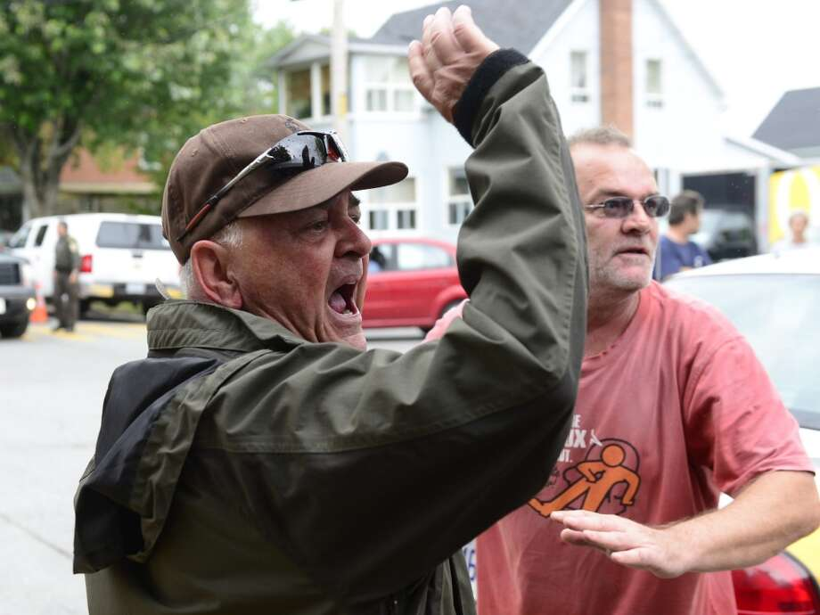 Angry citizens heckle Rail World Inc. president Edward Burkhardt  as he tours Lac-Megantic, Quebec, on Wednesday, July 10, 2013.  A Rail World oil train train crashed into the town, killing at least 15 people. (AP Photo/The Canadian Press, Paul Chiasson) Photo: Associated Press