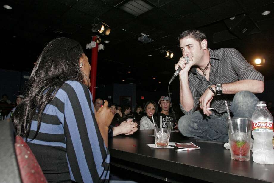Bill Olive-for the chronicle. 02/21/08. 526 Waugh Dr., Houston, Tx. The Whiskey Brothers' Slade Ham heckles an audience member during his performance Wednesday at the Laff Stop. Photo: For The Chronicle