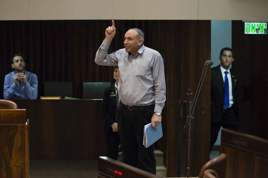 Parliament Member Moti Yogev interrupts the speech of President of the European Parliament Martin Schultz at the Knesset, Israel's parliament, in Jerusalem, on February 12, 2014. Schultz was speaking before the Israeli house Wednesday when he made comments regarding the Palestinians' freedom of movement and access to water resources. Members of the Jewish Home party then heckled him, accusing him of spreading lies and anti-Israel propaganda before storming out. The protests included veiled references to the Holocaust and Schultz's German heritage. (AP Photo/David Vaaknin) *** ISRAEL OUT*** Photo: Associated Press