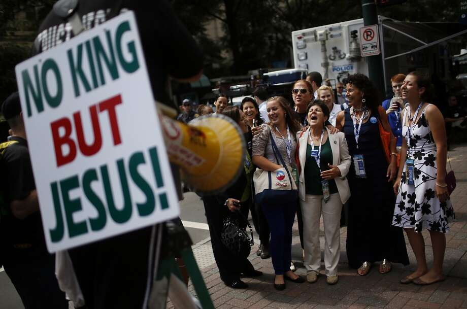 A group of women heckle a religious protestor on the street before the start of day two of the Democratic National Convention (DNC) in Charlotte, North Carolina, U.S., on Wednesday, Sept. 5, 2012. Democratic officials have moved President Barack Obama's nomination acceptance speech tomorrow night to the Time Warner Cable Arena from the larger, outdoor Bank of America Stadium because of the possibility of severe weather. Photographer: Victor J. Blue/Bloomberg Photo: Bloomberg
