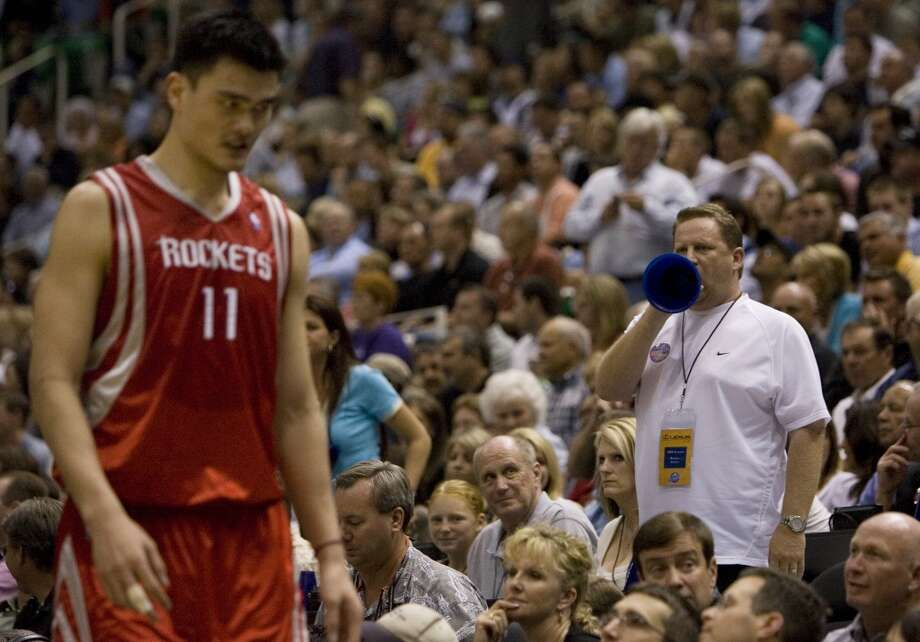 Houston Rockets Yao Ming is heckled by a Utah Jazz  fan as he is pulled out of the game during second quarter action in Game 3 of the NBA Western Conference first round playoffs  Thursday, April 26, 2007, in Salt Lake City. ( Smiley N. Pool / Chronicle ) Photo: Houston Chronicle