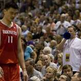 Houston Rockets Yao Ming is heckled by a Utah Jazz  fan as he is pulled out of the game during second quarter action in Game 3 of the NBA Western Conference first round playoffs  Thursday, April 26, 2007, in Salt Lake City. ( Smiley N. Pool / Chronicle )