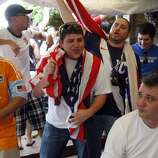 "Robert Ford (right) who is originally from London, England but now lives here in Houston, is heckled by U.S. soccer fans, (L to R) Malik Smith, Jason McClelland and Eric Ramirez  as hundreds of U.S. and England fans gathered at Richmond Arms Pub to watch the U.S. and England played to a 1-1 tie in the World Cup Friday, June 11, 2010, in Houston.  When asked how important the game was for England, Ford said. ""It doesn't compare to my first born, but perhaps my second. I may be leaving the country this afternoon if we lose."" ( Johnny Hanson / Chronicle )"