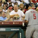 A fan heckles Albert Pujols who walks back to the dugout after striking out during the 9th inning of the Houston Astros-St. Louis Cardinals MLB baseball game at Minute Maid Park,  Saturday, July 10, 2010. Astros won the game 4-1.  ( Karen Warren / Houston Chronicle )