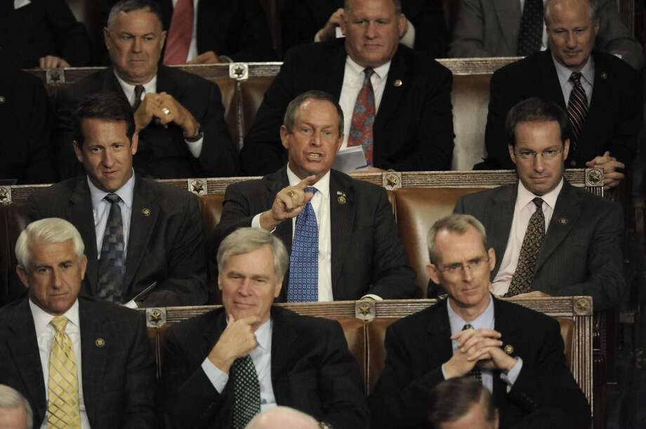 """** ADDS TO CLARIFY THIS IS THE MOMENT WILSON SAYS """" YOU LIE """""""" ** In this Wednesday Sept. 9, 2009, Rep. Joe Wilson, R-S.C., center, points and says """"You lie!"""" as President Barrack Obama addresses a Joint Session of Congress concerning healthcare, in Washington. (AP Photo/The Washington Post, Melina Mara)   WASHINGTON TIMES OUT; NEW YORK TIMES OUT;USA TODAY OUT; DC EXAMINER OUT; NO SALES; NO ARCHIVES; NO MAGS; MANDATORY CREDIT Photo: AP"""