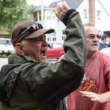 Angry citizens heckle Rail World Inc. president Edward Burkhardt  as he tours Lac-Megantic, Quebec, on Wednesday, July 10, 2013.  A Rail World oil train train crashed into the town, killing at least 15 people. (AP Photo/The Canadian Press, Paul Chiasson)