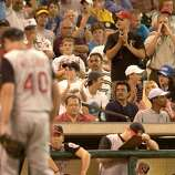 (7/10/03)  Reds starting pitcher, paul Wilson is heckled as he walks back to the dugout after being pulled by the manager, after giving up 6-runs with no outs to the first 8 batters he faced, during the Houston Astros-Cincinnati Reds baseball game at Minute Maid Park, Thursday evening.  (Karen Warren/Houston Chronicle)