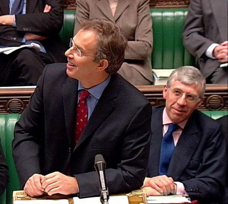 Britain's Prime Minister Tony Blair looks up to the public gallery where protesters where heckling him as he opened the debate on the Hutton Report in the  House of Commons, London, in this image from television Wednesday Feb. 4, 2004. The session was suspended for ten minutes after the prolonged outburst so that the public gallery could be cleared. At right is Britain's Foreign Minister Jack Straw. (AP Photo/House of Commons TV via PA) ** UNITED KINGDOM OUT  MAGAZINES OUT  NO SALES  TV OUT **  HOUCHRON CAPTION (O2/05/2004):  Prime Minister Tony Blair gazes at protesters in the public gallery as he opens debate in the House of Commons. Photo: AP