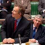 Britain's Prime Minister Tony Blair looks up to the public gallery where protesters where heckling him as he opened the debate on the Hutton Report in the  House of Commons, London, in this image from television Wednesday Feb. 4, 2004. The session was suspended for ten minutes after the prolonged outburst so that the public gallery could be cleared. At right is Britain's Foreign Minister Jack Straw. (AP Photo/House of Commons TV via PA) ** UNITED KINGDOM OUT  MAGAZINES OUT  NO SALES  TV OUT **  HOUCHRON CAPTION (O2/05/2004):  Prime Minister Tony Blair gazes at protesters in the public gallery as he opens debate in the House of Commons.