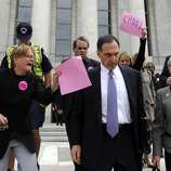 FILE - In this Oct. 6, 2008 file photo, Lehman Brothers Holdings Inc. Chief Executive Richard S. Fuld Jr., front center, is heckled by protesters as he leaves Capitol Hill in Washington after testify before the House Oversight and Government Reform Committee on the collapse of Lehman Brothers. A report by U.S. bankruptcy-court examiner faults Lehman Brothers  executives and auditor Ernst & Young for serious lapses that led to the largest bankruptcy in U.S. history. Will former CEO Richard Fuld be held accountable?(AP Photo/Susan Walsh, file)