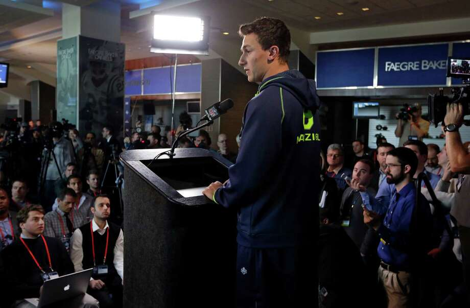 Media interest in what Texas A&M quarterback Johnny Manziel had to say was at an all-time high Friday at the NFL combine. Photo: Michael Conroy, STF / AP