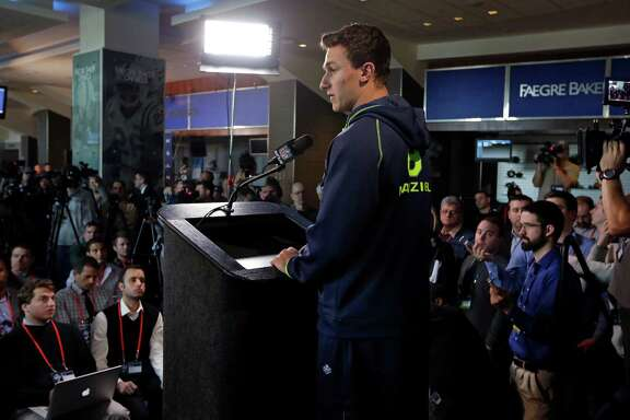 Media interest in what Texas A&M quarterback Johnny Manziel had to say was at an all-time high Friday at the NFL combine.
