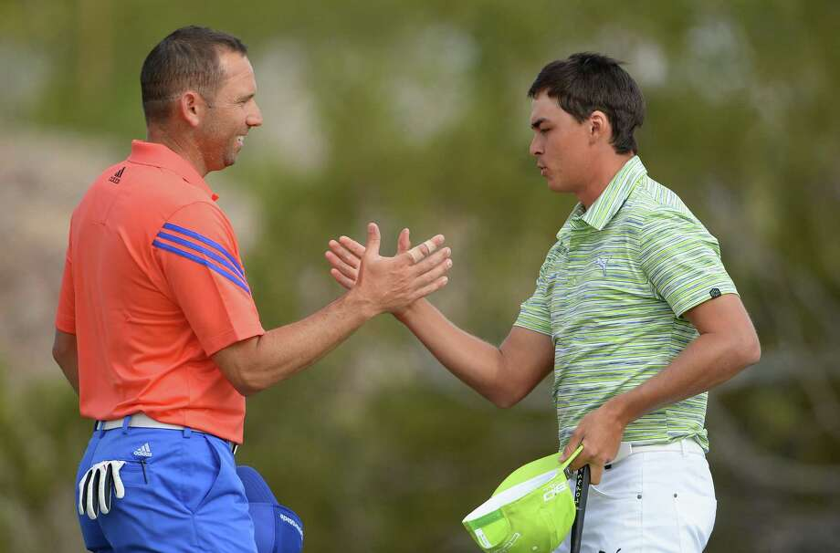 Sergio Garcia (left) and Rickie Fowler shake hands after Fowler's 1-up victory put him into the quarterfinals of the Match Play Championship, where he'll face fellow American Jim Furyk. Photo: Stuart Franklin / Getty Images / 2014 Getty Images