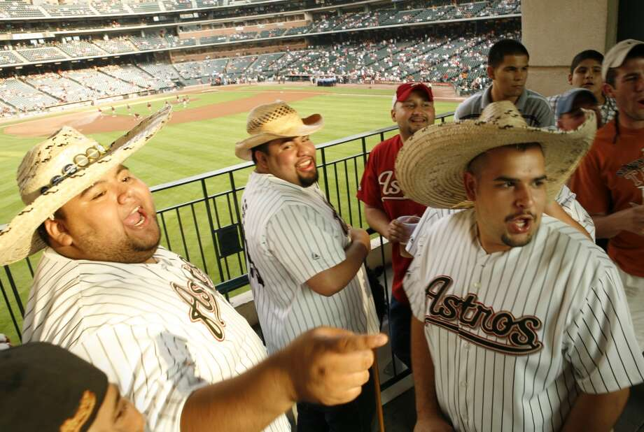 Houston Astros outfielder Carlos Lee fans called the Los Caballitos, Daniel Quijada, from left, Ernesto Quijada, Hector  Flores, red hat and jersey, and Emanuel Martinez heckle a San Francisco Giants fan before the Houston Astros play the Giants at Minute Maid Park Wednesday, May 16, 2007, in Houston.  This photo accompanies a David Barron sports story.  ( Kevin Fujii / Chronicle ) Photo: Houston Chronicle