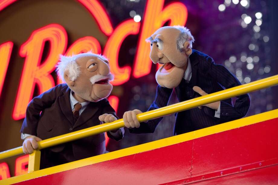 """THE MUPPETS""   THEY MADE ANOTHER MUPPET MOVIE?   STATLER and WALDORF may not be in the balcony but it doesnít stop them from heckling their fellow Muppets in THE MUPPETS. (Opening in theaters Nov. 23rd). Ph: Scott Garfield ©2011 Disney Enterprises, Inc. All Rights Reserved."