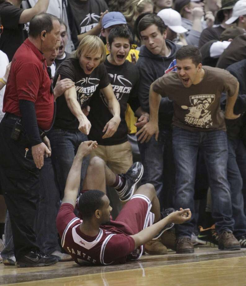 Fans heckle Massachusetts guard Clyde Santee after he tumbled to the court during the first half of an NCAA college basketball game against St. Bonaventure in St. Bonaventure, N.Y.  Wednesday, Jan 29, 2014. (AP Photo/Nick LoVerde) Photo: Associated Press
