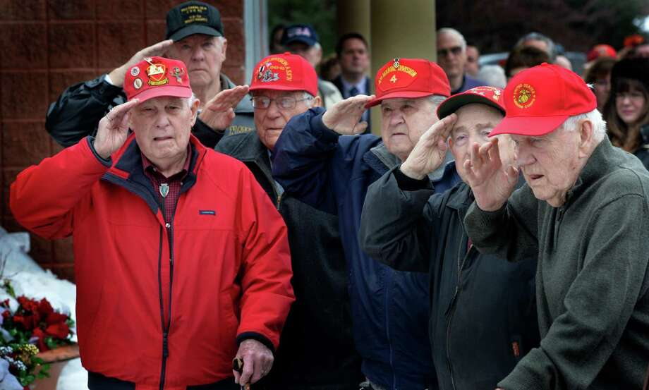 Veterans of the WWII Pacific Theatre salute to the mournful tune of TAPS during a special ceremony to honor their service to the country Friday morning, Feb. 20, 2014, at the Zaloga Post in Albany, N.Y. (Skip Dickstein / Times Union) Photo: SKIP DICKSTEIN / 00025808A