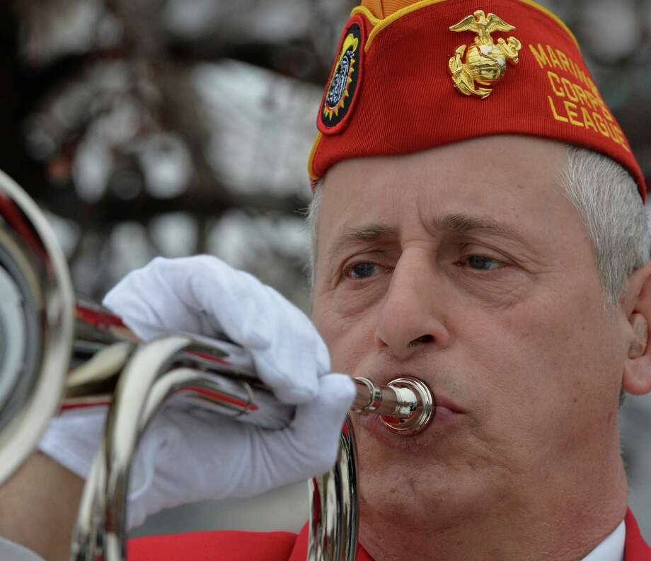 Tim Forbes of the Troy Marine Corps League plays TAPS during the opening ceremony of a service which honored veterans of the WWII Pacific Theatre Friday morning, Feb. 20, 2014, at the Zaloga Post in Albany, N.Y. (Skip Dickstein / Times Union) Photo: SKIP DICKSTEIN / 00025808A