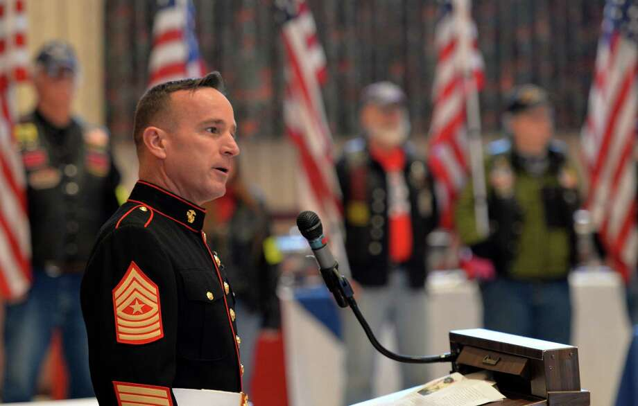 Sgt. Major John D. Calhoun gives the keynote speech during the ceremony honoring veterans of the WWII Pacific Friday morning, Feb. 20, 2014, at the Zaloga Post in Albany, N.Y. Sgt. Major Calhoun is a decorated Marine who has served in the Middle East.  (Skip Dickstein / Times Union) Photo: SKIP DICKSTEIN / 00025808A
