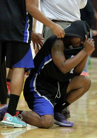 Westside guard Nicholas Anderson (4) can't hold back his emotion as they lose to Cypress Woods 66-64