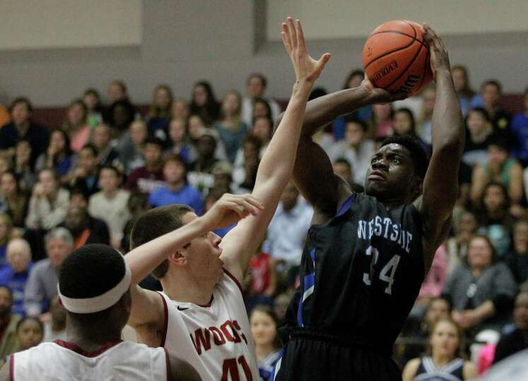 Westside forward Daniel Utomi (34) takes a shot over Cypress Wood Hogan Choyce during the second hal