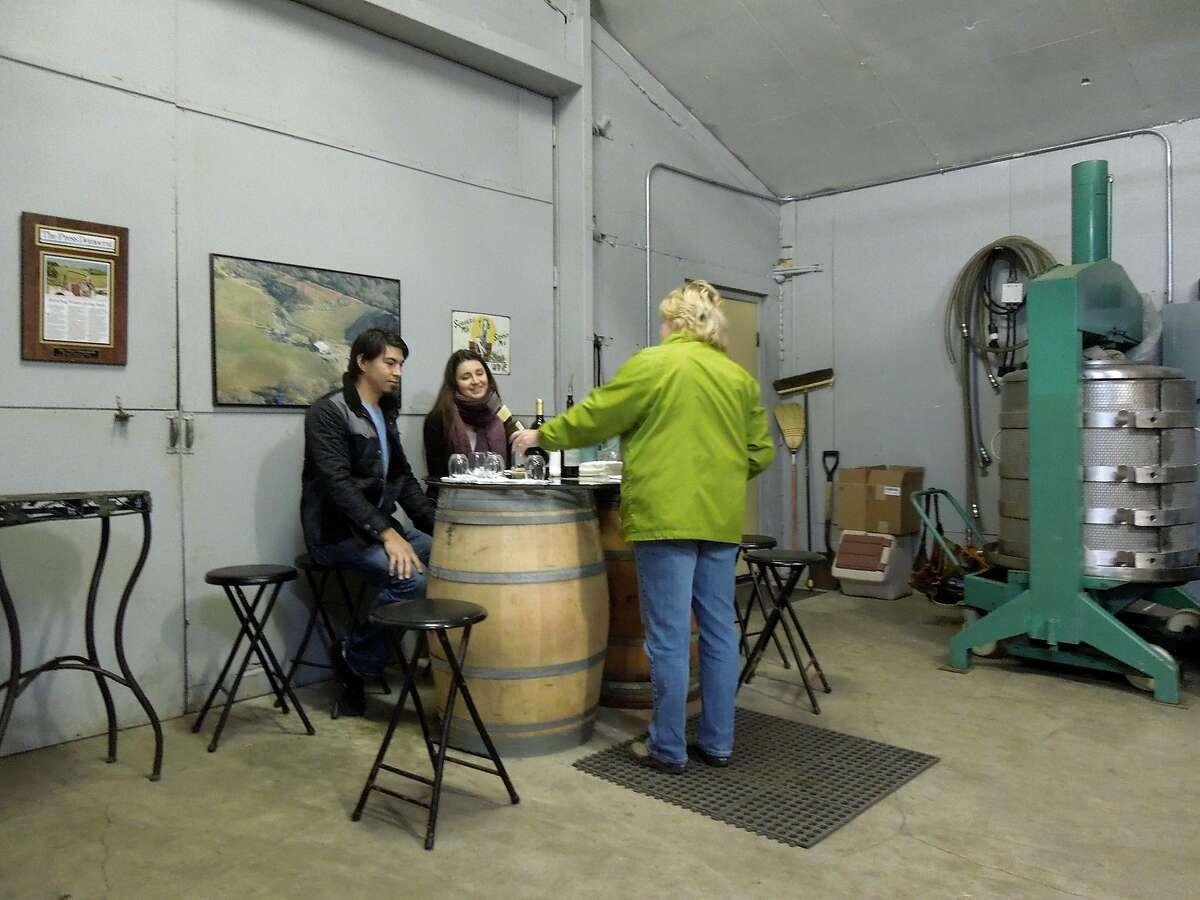 Kandy Ward serves guests at BobDog Wines in Cloverdale.