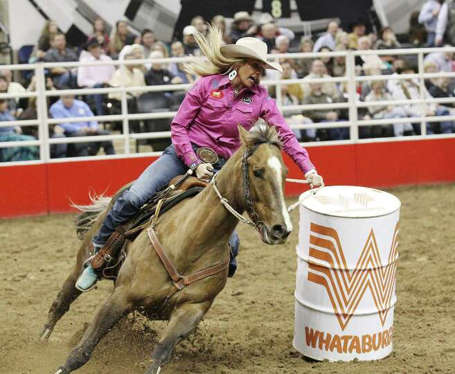 Shada Brazile of Decatur, Texas rounds the last barrel for a time of 14.08 in the barrel racing on F