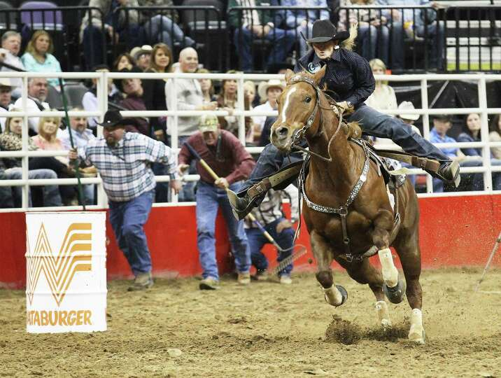 Jana Bean of Ft. Hancock, Texas clears a barrel for a time of 14.04 in the barrel racing on Friday,