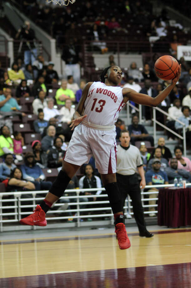Cy-Woods junior guard Erica Ogwumike pulls down a rebound against Pearland during their Region III-5A semifinal playoff at the M.O. Campbell Center on Friday. Photo: Jerry Baker, For The Chronicle
