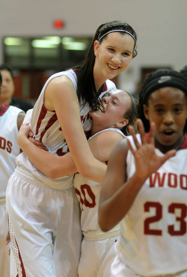 Cy Woods 64, Pearland 49 Cy-Woods sophomore post Nancy Mulkey, left, gets a hug from teammate Ashley Foster after the Lady Wildcat's win over Pearland in their Region III-5A semifinal matchup at the Campbell Center in Houston on Friday. Photo: Jerry Baker, For The Chronicle