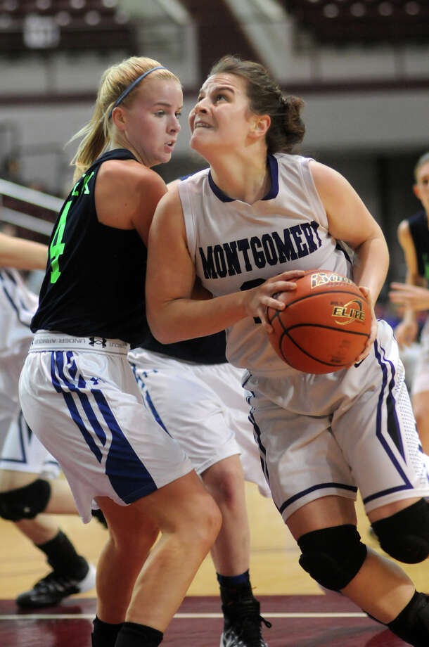 Montgomery 64, Friendswood 49Montgomery junior forward Rina Rraci, right, sets for a shot against Friendswood senior guard Shelby Pioterek during their Region III-4A semifinal basketball playoff at the M.O. Campbell Edcational Center on Friday. Photo: Jerry Baker, For The Chronicle