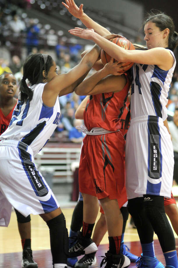 Terry junior guard Priscilla Rodriguez, center, gets smothered by Georgetown defenders Taylor Green, left, and Amanda Johnson on her way to the basket during their Region III-4A semifinal playoff at the M.O. Campbell Educational Center on Friday. Photo: Jerry Baker, For The Chronicle