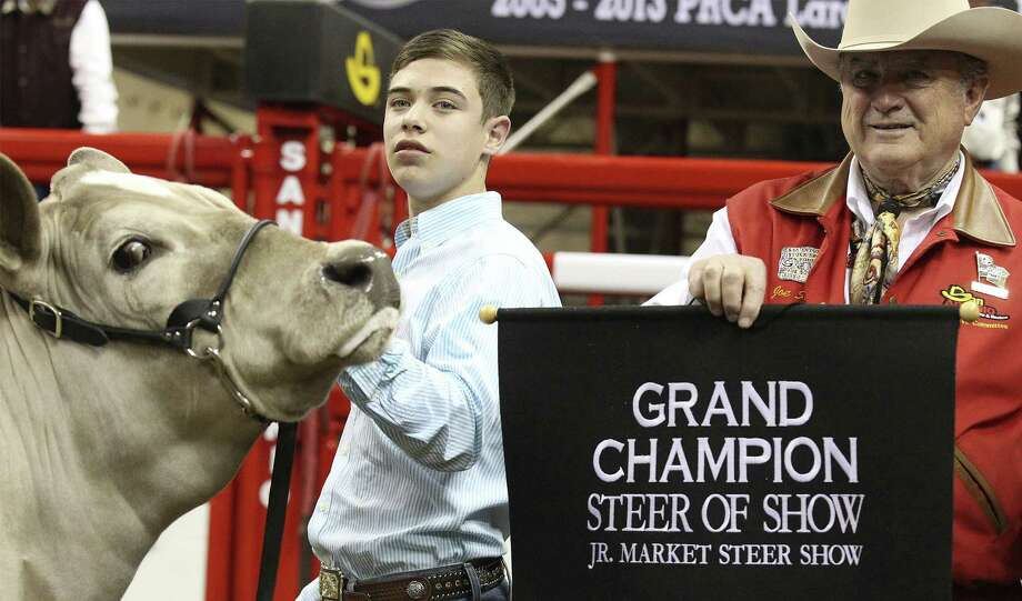 "Beaver looks toward the camera as San Antonio Stock Show & Rodeo Chairman Joe Soules brings out the grand champion banner for Braeden Raub. ""I'm just so happy,"" Braeden said. Photo: Kin Man Hui / San Antonio Express-News / ©2013 San Antonio Express-News"