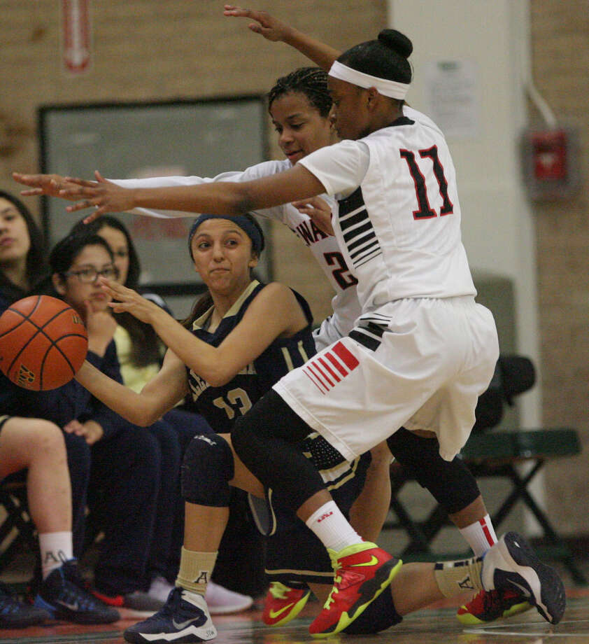 Laredo Alexander's Ashley Ortiez (left) is trapped by Wagner's Kiauna Clark and Desierre Johnson during the Thunderbirds' 68-31 regional semifinal win. Photo: Courtesy Photos / Delcia Lopez photography