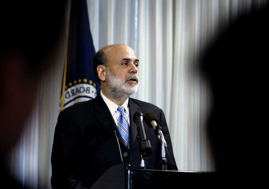 FILE - In this  Thursday, Dec. 4, 2008, file photo, Federal Reserve Chairman Ben Bernanke speaks on housing and housing finance, at the Federal Reserve in Washington .Federal Reserve officials agonized throughout 2008 over how far they could go to stop a financial catastrophe that threatened to pull the economy into a deep recession, transcripts of the Fed's policy meetings that year show.  (AP Photo/Jose Luis Magana, File) Photo: Jose Luis Magana, STF / AP
