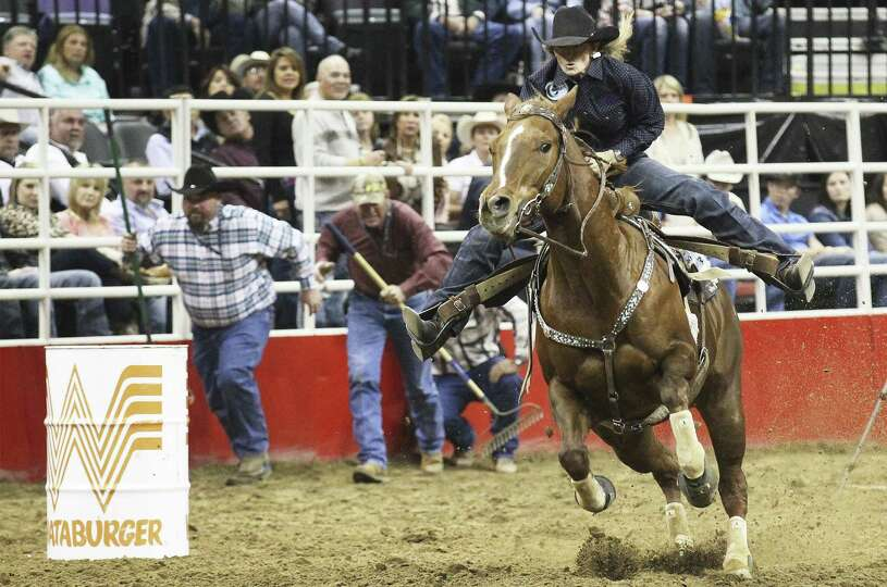 Jana Bean of Ft. Hancock clears a barrel for a time of 14.04 in the barrel racing on Friday.