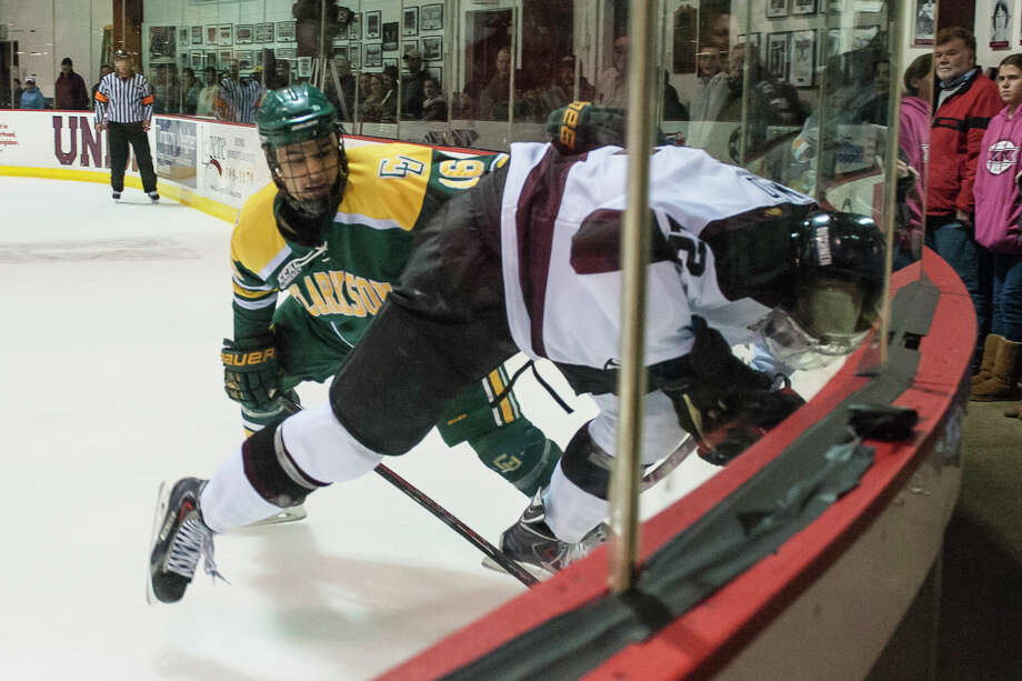 Union Dutchmen forward Eli Lichtenwald gets checked head first into the glass by Clarkson Golden Knights forward Troy Josephs during the second period Friday night, Feb. 21, 2014, in Schenectady, N.Y. (Gregory Fisher/Special to the Times Union) Photo: GF / 00025790A