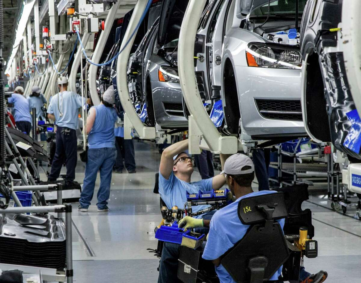 Workers assemble Volkswagen Passats at the automaker's plant in Chattanooga, Tenn. They voted against a union this month.