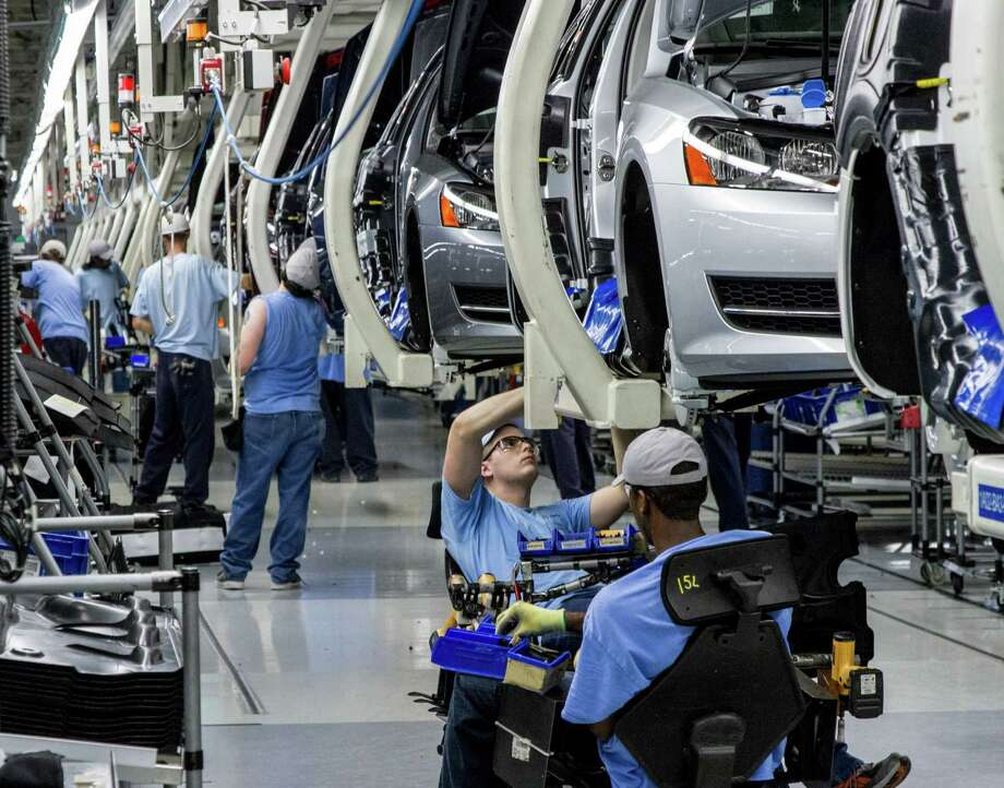 Workers assemble Volkswagen Passats at the automaker's plant in Chattanooga, Tenn. They voted against a union this month. Photo: Erik Schelzig, STF / AP