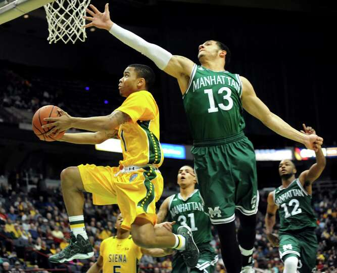 Siena's Marquis Wright, left, goes to the hoop as Manhattan's Emmy Andujar defends during their bask